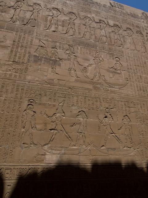 A wall with heiroglyphics carved onto he wall