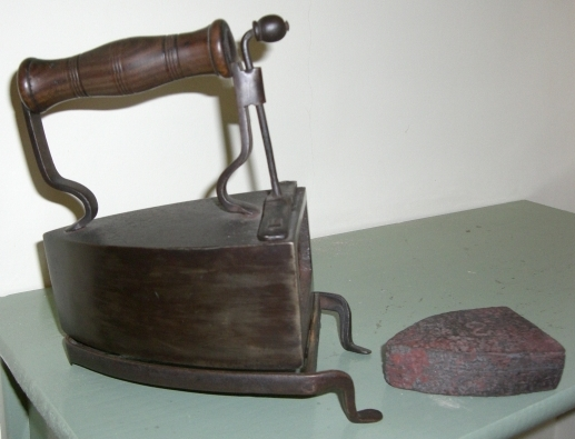 Once clothes were dry they needed to be ironed to get rid of all the creases. A box iron contained a slug which was heated on the range and then placed inside the iron. Flat irons were placed on the range to heat.