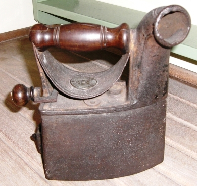 Charcoal irons had a compartment for hot charcoal to go into. Do you think they were very clean?