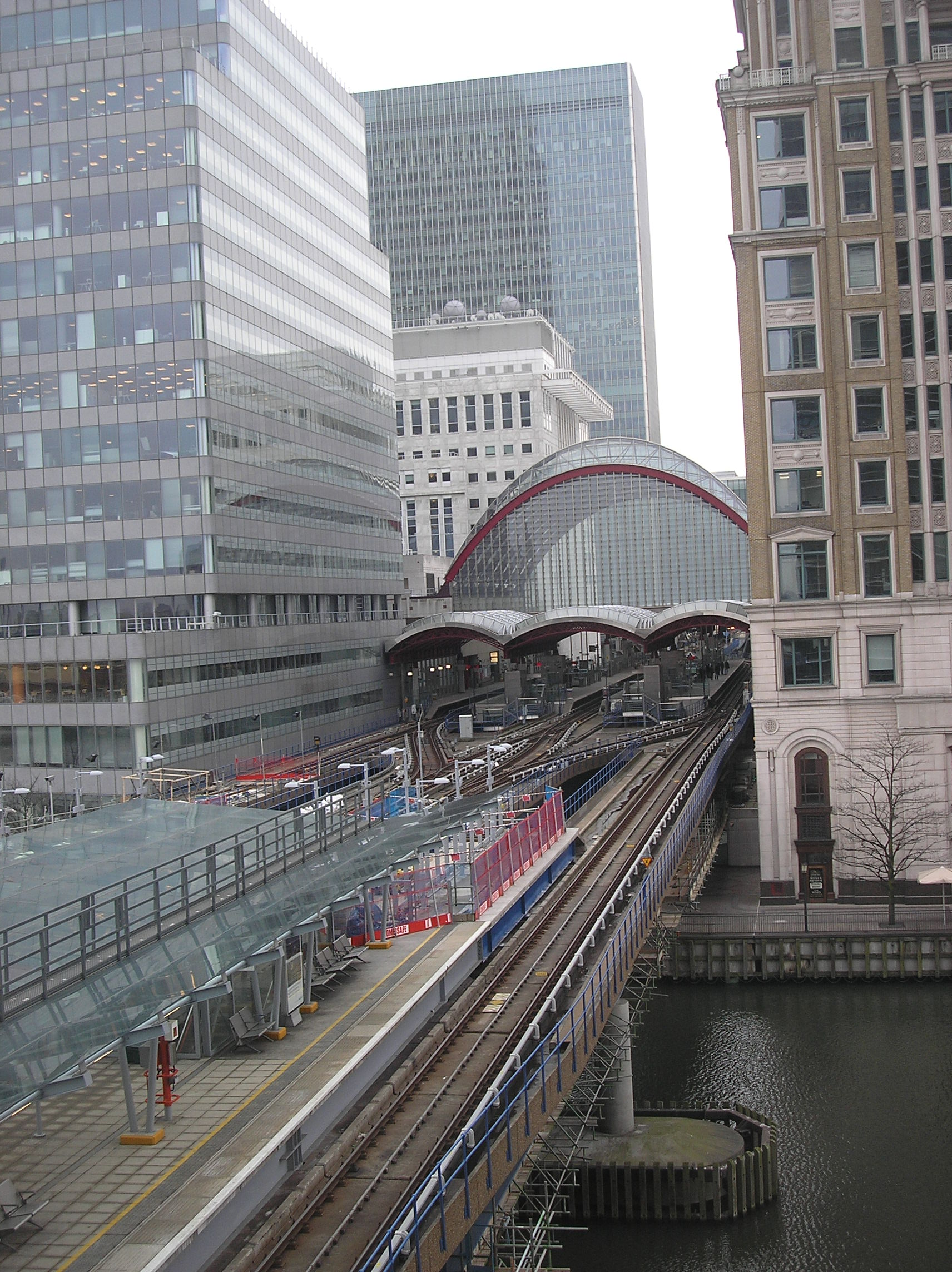 This photo shows Canary Wharf DLR (Docklands Light Railway) station. The station is situate at the foot of the Canary Wharf Tower. The line continues north towards West India Quay and south towards Heron Quays.