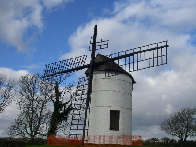 Windmill in a field.