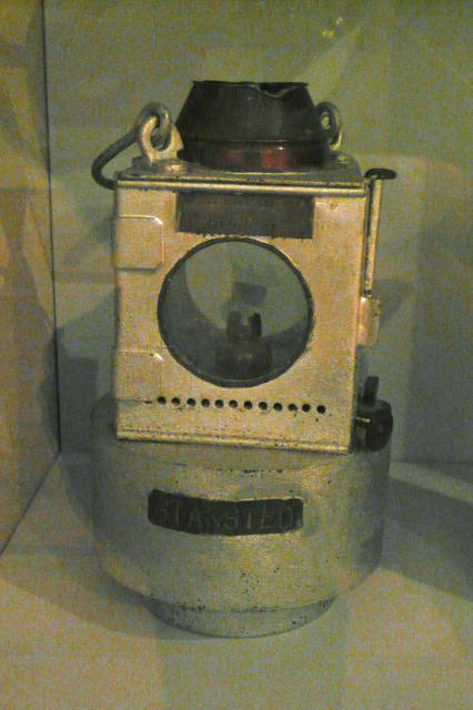 This lantern is an early twentieth century example from Stansted's railway. It would have been mounted on to the front of the train to warn people that the train was there rather than to give any real light to the driver. The lantern would have burnt oil to produce light