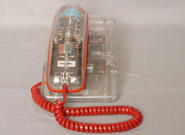 A plastic, see through telephone of the 1970's, you can see all the working parts