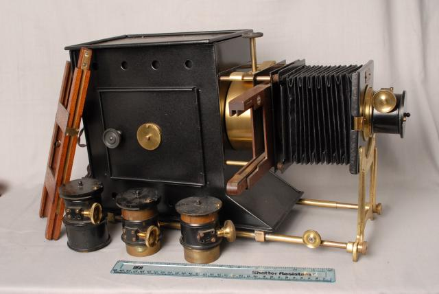 This Magic Lantern has an electric lamp mounted inside that looks original, although it is possible it may have been converted by a professional from an earlier oil lamp.                                                                                                                                  ...