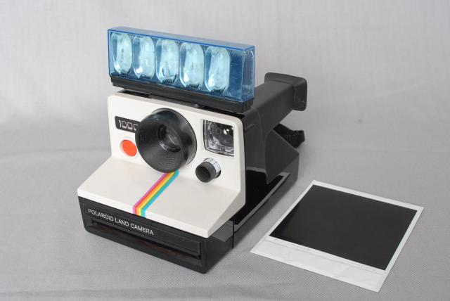 There were many different designs of the Polaroid Camera, it produced instant pictures, you just had to wait for the picture to dry, which usually took about 5 minutes