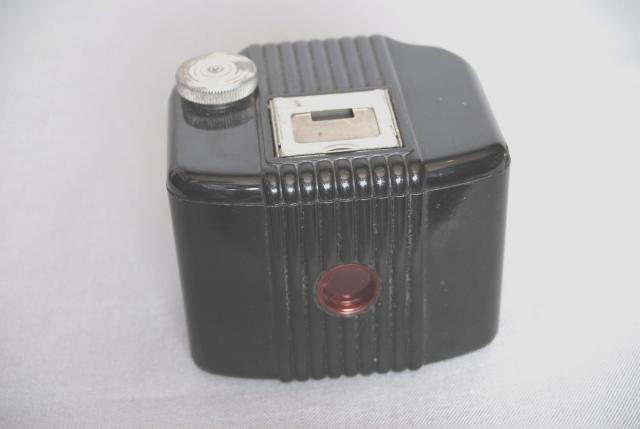Kodak's Baby Brownie Camera had a plastic Bakelite body instead of the metal one usually found on the Brownie range. It also had a folding range finder on the top and a rotary shutter. This camera was produced in the USA between 1934 and 1941.
