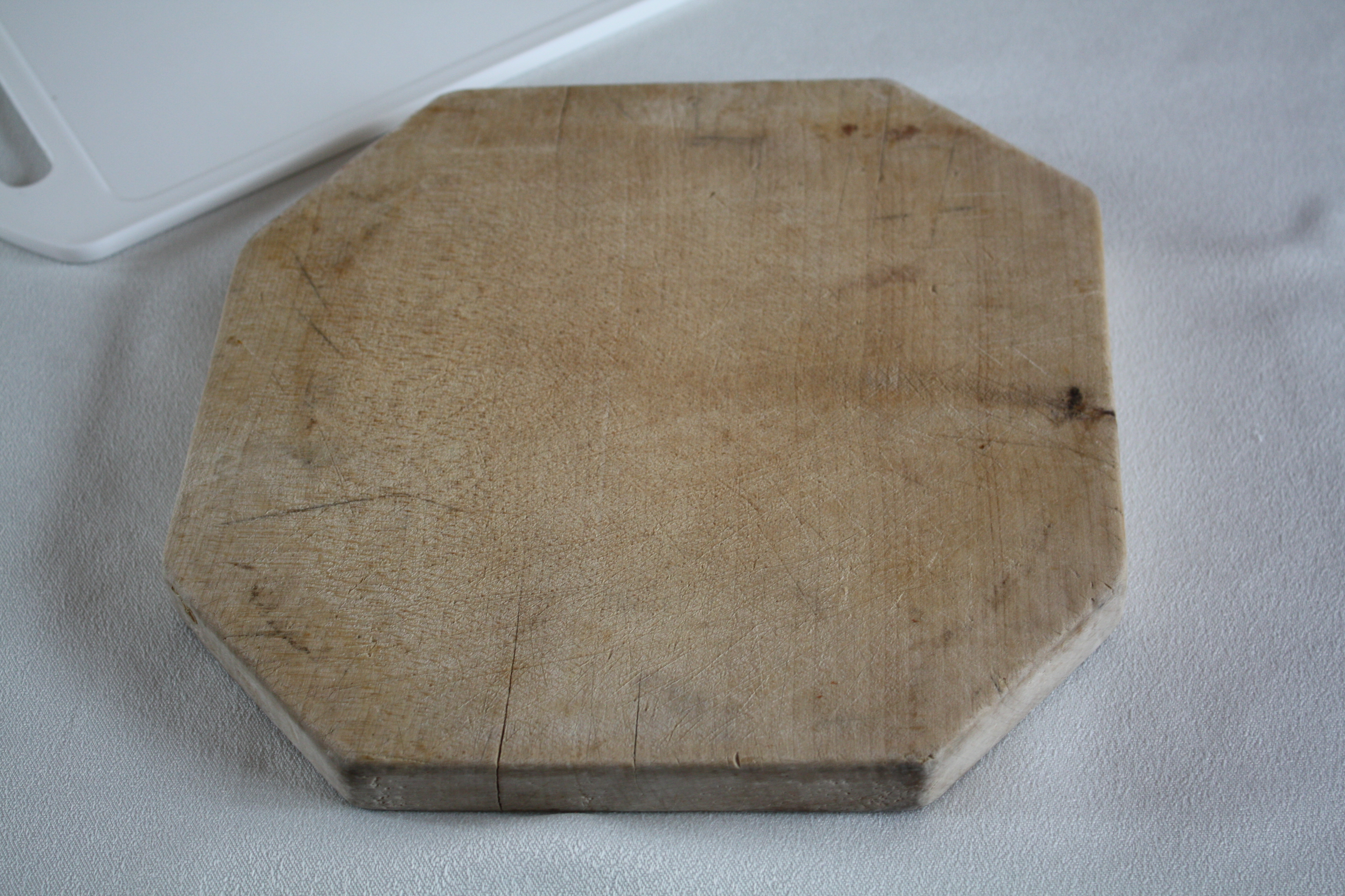 A chopping board or cutting board, is a kitchen utensil used as a flat surface on which to cut or slice things. Cutting boards are often made of wood or plastic. Care needs to be taken in cleaning them as bacteria can grow in grooves produced by cutting, or in liquids left on the board. For this rea...