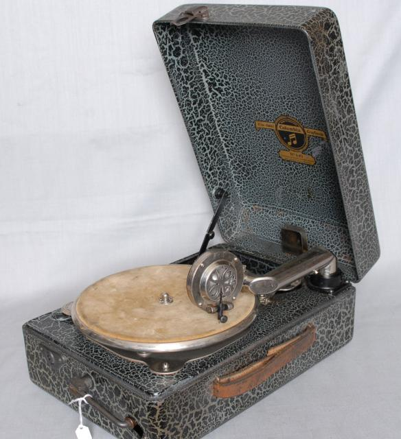 This Gramophone is made of steel and was completly portable.  Made in England by Columbia, the Trade Mark for EMI Records. It played 78rpm records