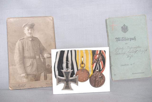 Medals including Iron Cross 2nd class of 1823, photo of owner and record book dated 1915.