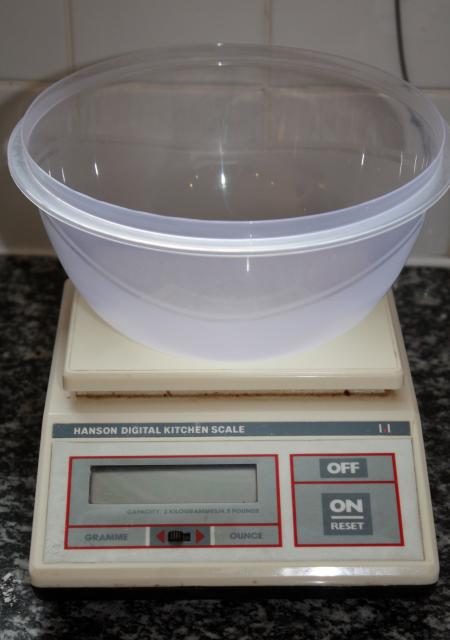 A measuring instrument for determining the weight or mass of an ingredient against a pre determined scale. They come in a variety of shapes and sizes.