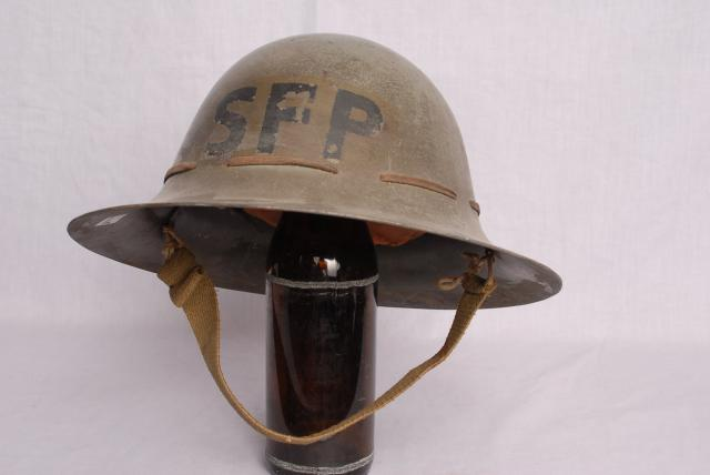 Helmets worn during World War Two by a section known as the Special Fire Patrol. Styled on the early British medieval helmet.