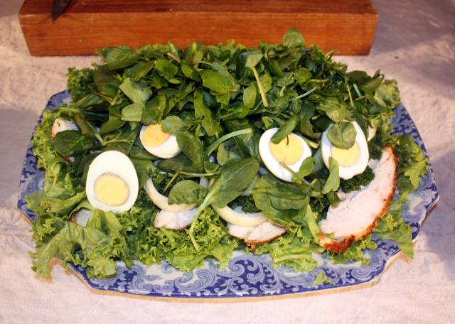 Sliced, cold, boiled eggs are added to the salad along with spinach or watercress.