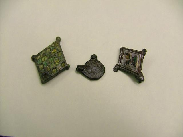 Three lids of seal boxes that were used in the Roman times used with wax to seal a wax tablet and keep the message private.