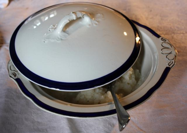 The china serving dish is covered with it's lid to keep the creamed turnips warm.