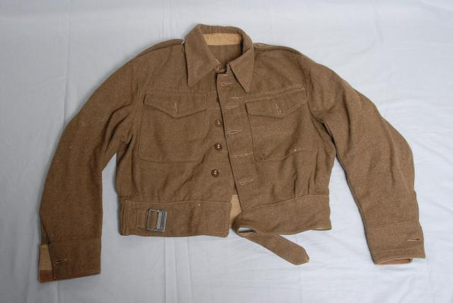 This is called a 1937 pattern battle dress, it is made of Khaki Wool Serge, this one is original and has a few moth holes. We have treated the garment so there are no more moths or eggs only holes.
