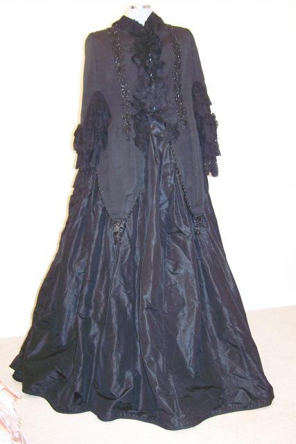 three piece suit comprising:i) Skirt, full length, black, bombazine ...