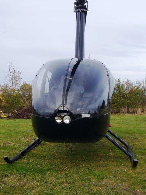 American built Robinson 44, four seater single engine helecopter.