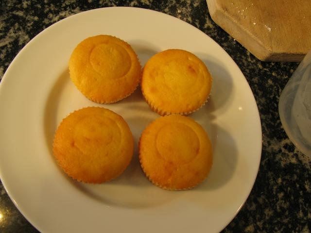 You can make your own or buy cup or fairy cakes.  It's easier to ice them if they have flat tops.