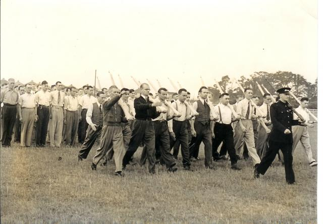 Bata factory, East Tilbury, home guard practice marching with wooden rifles. 2nd World War.