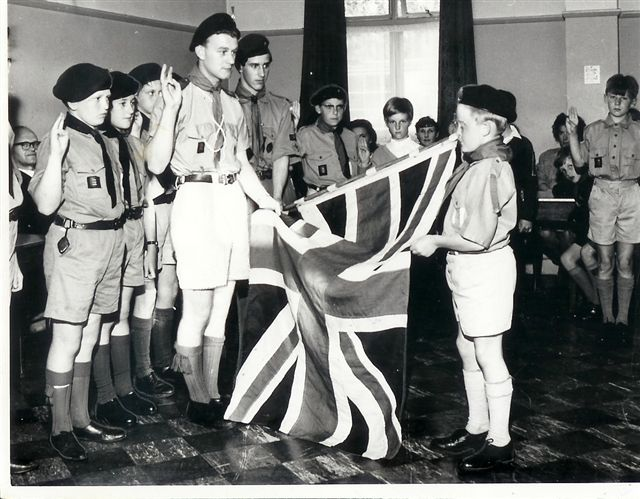Grays scout group perform the allegiance to Queen and country. 1960's