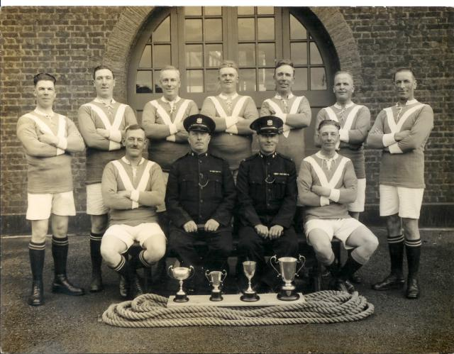 1930's. Note the tug of war rope and trophies.