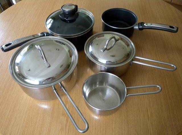 A saucepan is a vessel with vertical sides, about the same height as their diameter, used for simmering or boiling. Saucepans generally have one long handle. The are usually made of metal and come in a variety of sizes.