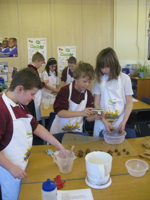 Learning with a laugh. Pupils from St Mary's Primary School, Tonwell, Hertfordshire, making gingerbread through the ages.