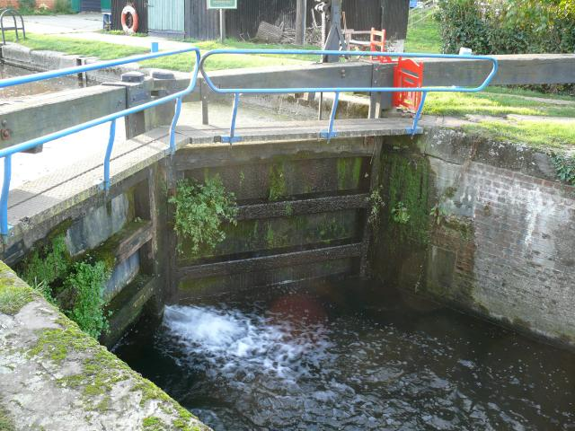 This lock is at the half way point in the journey along the Chelmer and Blackwater Navigation from Chelmsford to the coast. The navigation has 12 locks and 6 bridges all dating from the 1790's. It was completed in 1797 and enabled goods, mostly coal, bricks and timber, to be carried by barge instead...