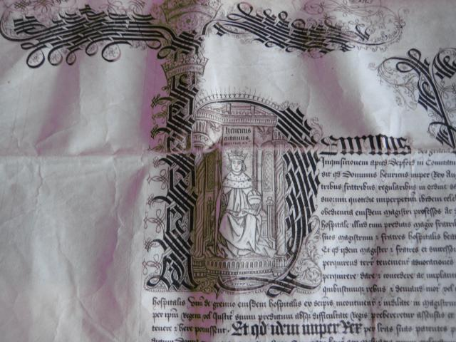 This is a promise to give some land to the College. The land is one of the presents that helped the College to grow. The benefactor (the person who gave this present) was Henry the Eighth. There is a picture of him in the big initial 'H' at the beginning of the writing.