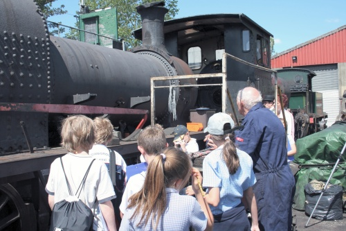 Children asking a driver howa steam engine works (on the Kent and East Sussex Railway)