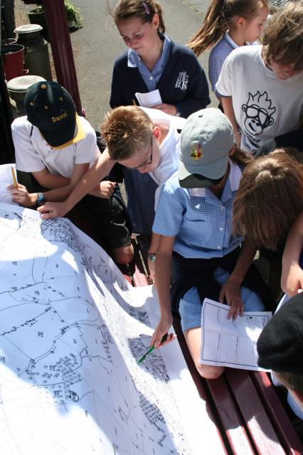The children are examining the 'secret' map to dscover where Colonel Stephens is building next! (at the Kent and East Sussex Railway)