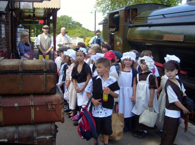Children in Victorian costume pose on Tenterden station before boarding a Victorian carriage during their experience day  (at the Kent and East Sussex Railway)