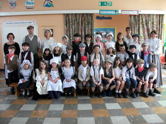 Children pose at school to show their fantastic Victorian costumes