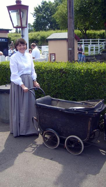 Mrs Galli gets a few minutes away from her pupils to pose at Bodiam with an authentic Victorian pram  (at the Kent and East Sussex Railway)