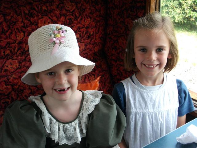 Two delightful young ladies pose to have their pictures taken during a Victorian experience day  (at the Kent and East Sussex Railway)