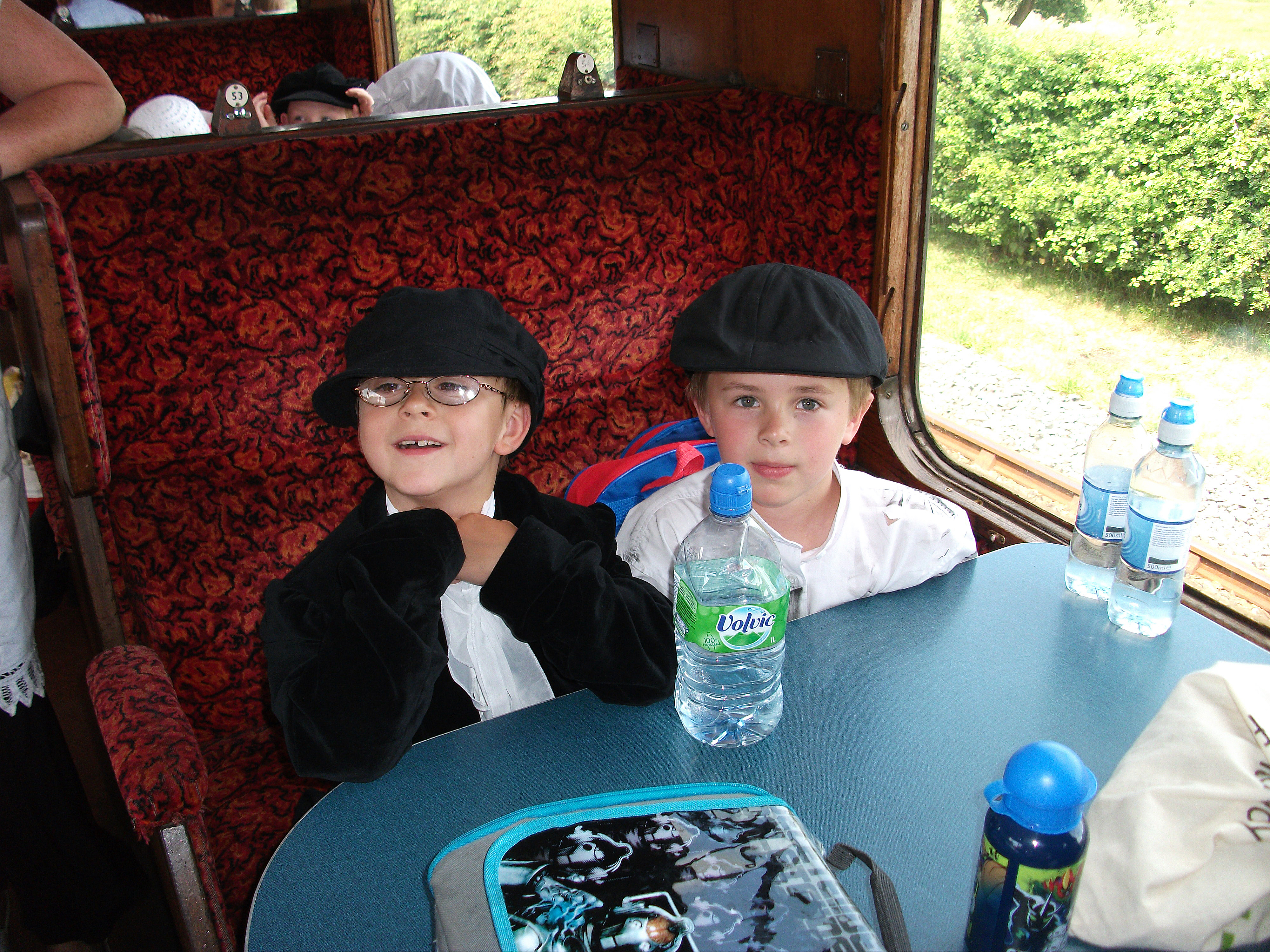 Two 'Victorian' boys are pleased they have modern water bottles during a hot day during their Victorian experience  (at the Kent and East Sussex Railway)