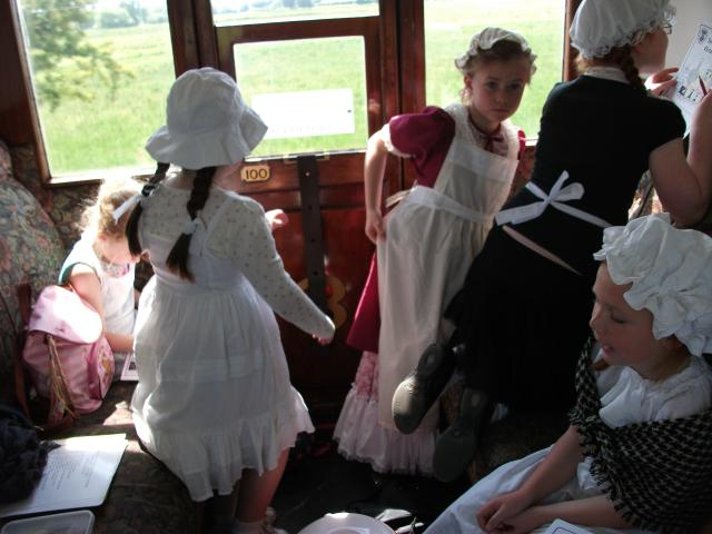 Victorian schoolgirls working in an authentic Victorian carriage as they travel on the Kent and East Sussex Railway during a Victorian Day.