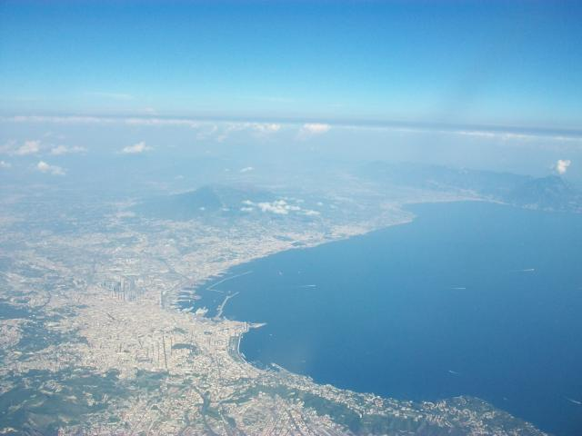 This photograph shows the city of Naples with the volcano, Mount Vesuvius in the centre of the picture. Vesuvius erupted violently in 79 A.D. destroying the cities of Pompeii and Herculaneum.
