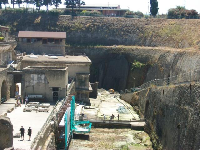 Herculaneum was an ancient Roman town destroyed by volcanic pyroclastic flows from Mount Vesuvius in 79 AD, along with other towns including Pompeii. The modern town of Ercolano now sits on top of much of the ancient buried city. The old shoreline is now more than 1 km inland.