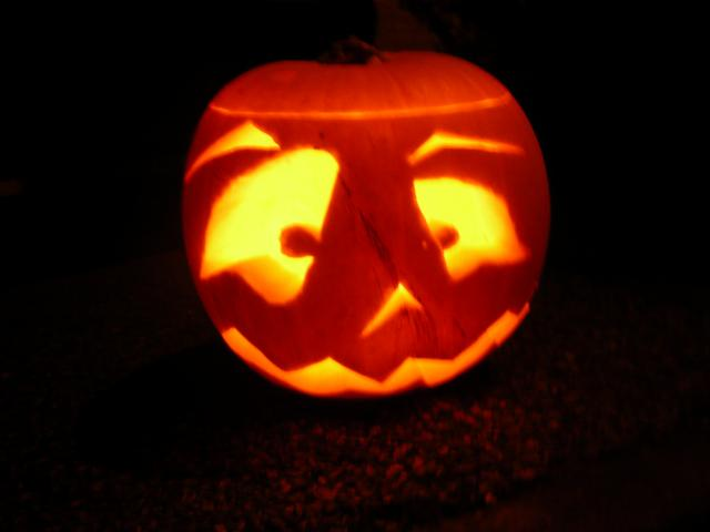 Halloween pumpkin lanterns. Pumpkins are carved into faces and patterns. Lights are put inside and the lantern is used to ward off spirits at Hallowe'en.