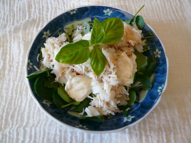 Crab meat salad with cream cheese and salad leaves.
