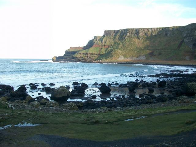 The Giant's Causeway is an area of about 40,000 interlocking basalt columns, the result of an ancient volcanic eruption. It is located in County Antrim on the northeast coast of Northern Ireland, about three miles northeast of the town of Bushmills. It was declared a World Heritage Site by UNESCO in...