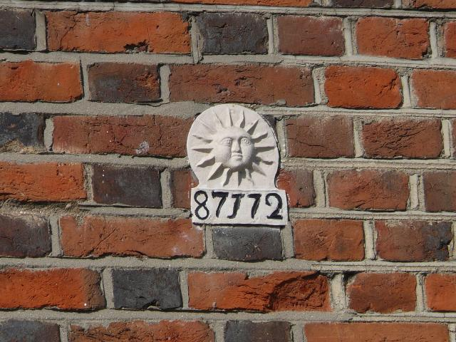 Fire insurance marks, with the sign of the insurance company, were placed on the front of the insured building as a guide to the insurance company's fire brigade. They were used during the eighteenth and nineteenth century in the days before fire services were formed