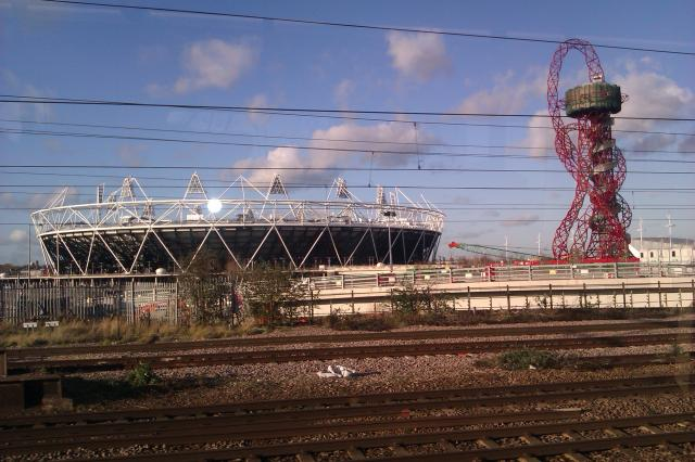 Anish Kapoor Tower and Olympic Stadium taken from the train to Pudding Mill station