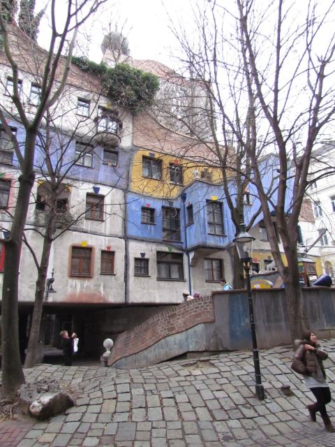 Although Hundertwasser first achieved notoriety for his boldly-coloured paintings, he is more widely known for his individual architectural designs. These designs use irregular forms, and incorporate natural features of the landscape. The Hundertwasserhaus apartment block in Vienna has undulating fl...