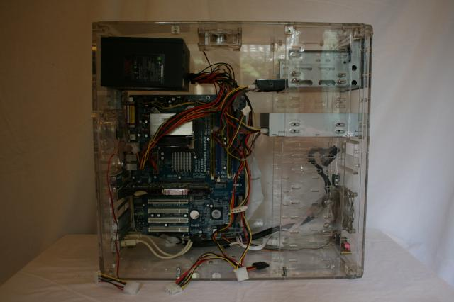 Motherboard, power supply, graphics card, memory, data cable. Disk drive and connect power and data cables connected. HArd drive inserted ad power and data cables connected