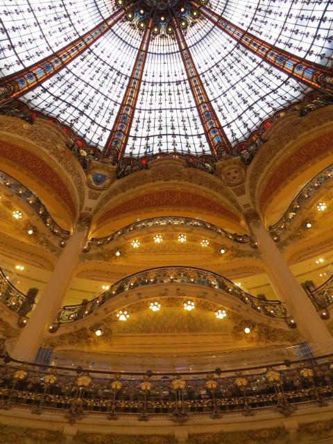 In 1895, Théophile Bader and his cousin Alphonse Kahn opened a fashion store in a small haberdasher's shop in Paris.  Bader commissioned the architect Georges Chedanne and his pupil Ferdinand Chanut to design a new store  where a glass and steel dome and Art Nouveau staircases were fini...