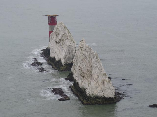 The Needles is a row of three stacks of chalk that rise out of the sea off the western extremity of the Isle of Wight, close to Alum Bay. The Needles lighthouse stands at the end of the formation. It was built in 1859 and has been automated since 1994.