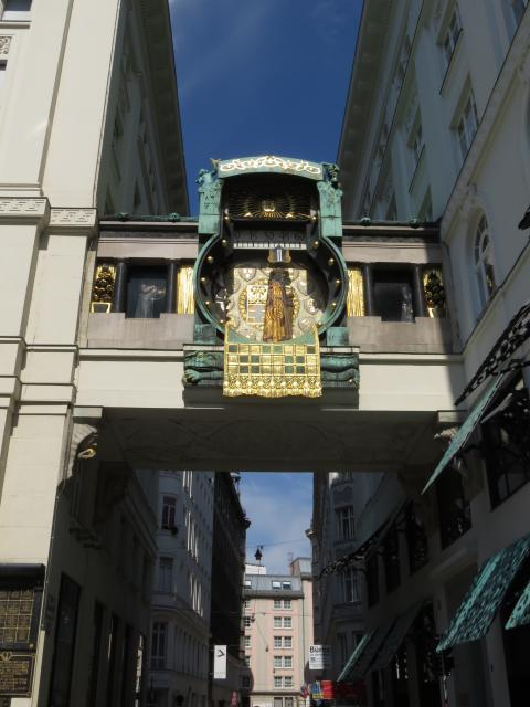 The Anker Clock was created by the artist Franz Matsch in 1911. It sits on a bridge spanning two buildings on the Hoher Markt. Every hour, on the hour, figures parade across the face of the clock.