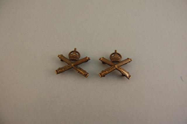 This is a set of collar badges for the Machine Gun Corps. The First World War was very much the war of the machine gun.